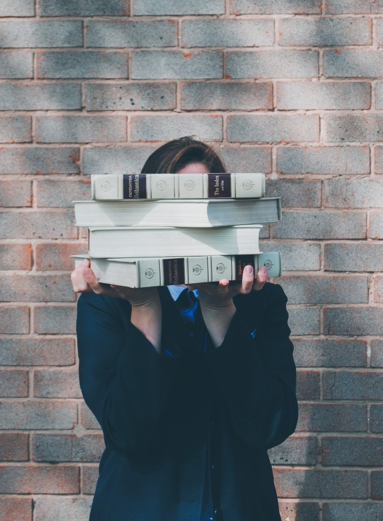 USA education 2021, girl holds books Siora Photography